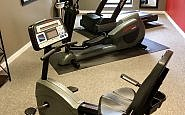 Three Life Fitness machines fill the hotel gym, including a treadmill.