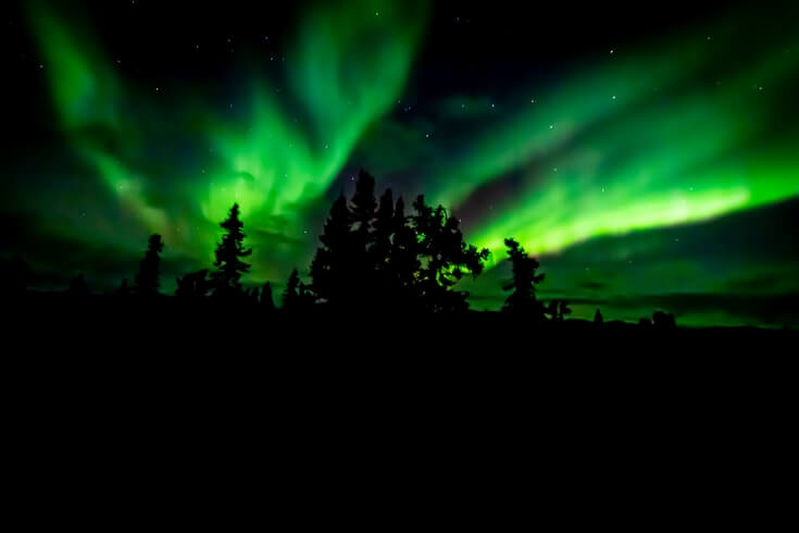 The night sky above Fairbanks dances with colors of green