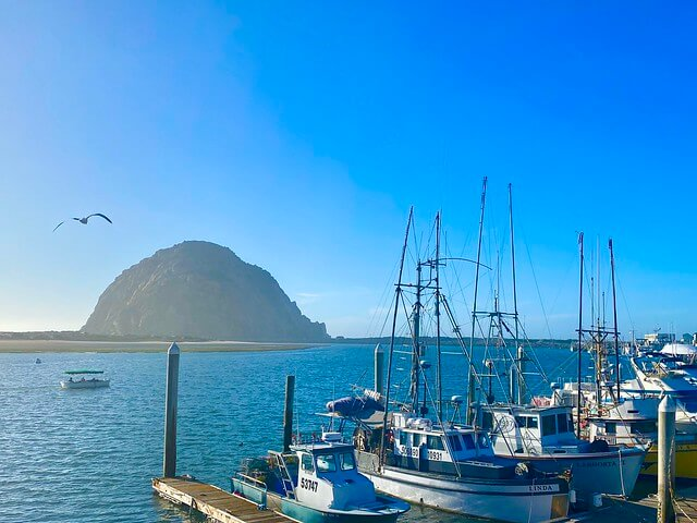 Fishing boats at Morro Bay with Morro Rock in background.