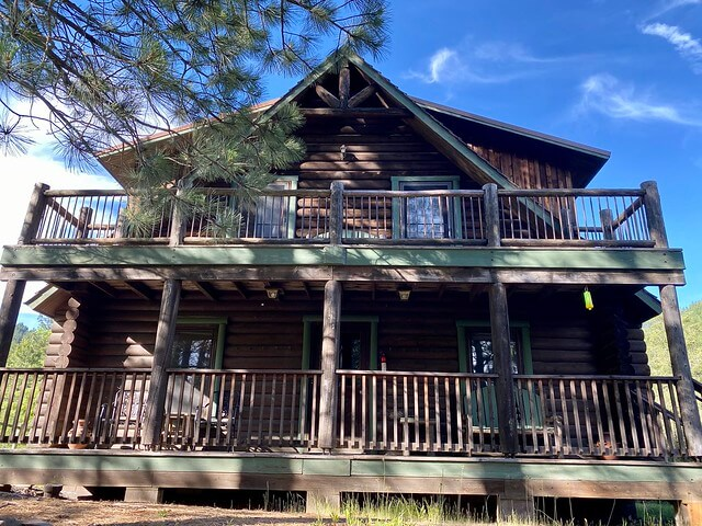 The two-story Eagle's Nest Cabin in a log cabin that sleeps 6-8 in four king suites.