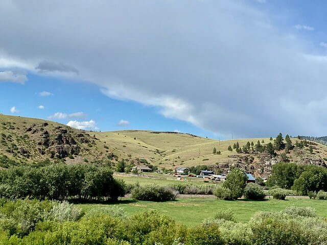 Rocking Z Guest Ranch is tucked into a valley in Wolf Creek, Montana, surrounded by lush grasses and forests.